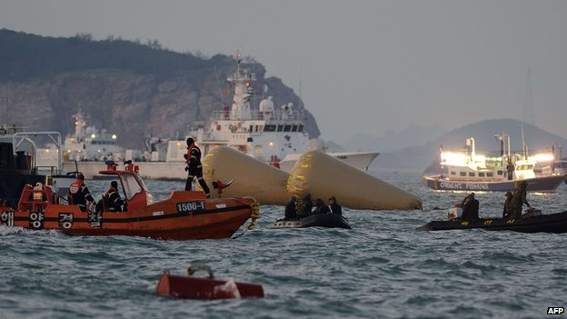 "Coast guard boats take part in recovery operations at the site of the ""Sewol"" ferry off the coast of the South Korean island of Jindo on 24 April 2014."