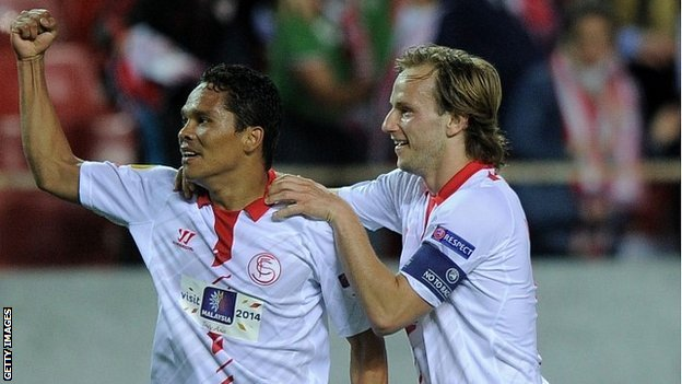 Carlos Bacca and Ivan Rakitic celebrate