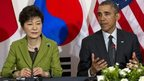 US President Barack Obama speaks next to South Korean President Park Geun-hye in The Hague on 25 March 2014