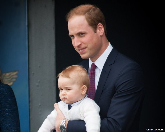 Prince George in the arms of his father, Prince William
