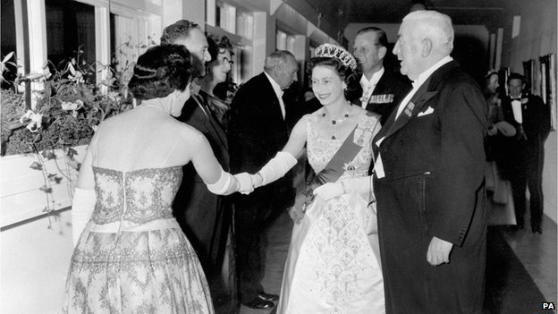 The Queen greets a guest at Parliament House, Canberra, during a tour in 1963
