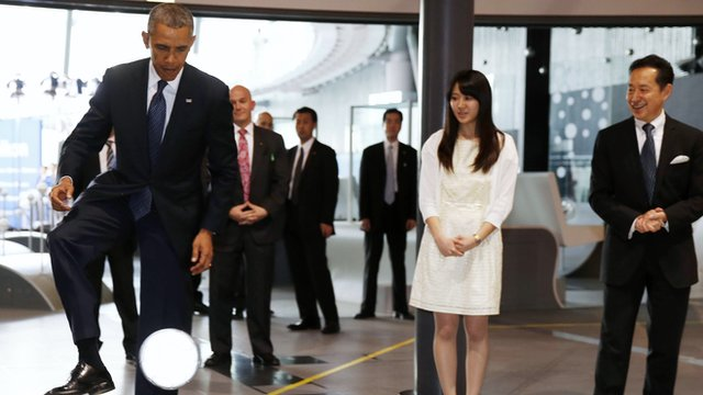 Obama playing football.