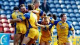 Leeds celebrate victory against St Helens in the Challenge Cup 2003