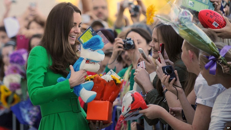 Princess Catherine is given gifts outside the National Portrait Gallery in Canberra .