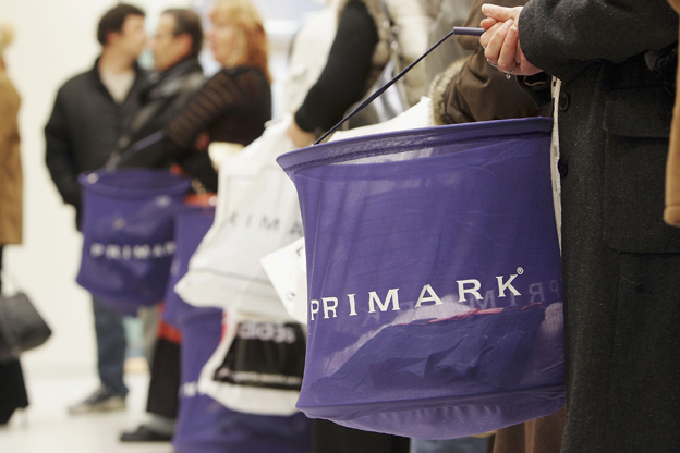 Customer holds Primark basket