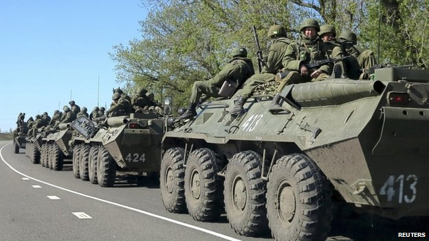 Russian servicemen drive armoured personnel carriers on the outskirts of the city of Belgorod near the Russian-Ukrainian border, 25 April 2014