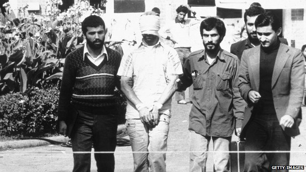 An American hostage with Iranian captors in Tehran, Iran, in 1979