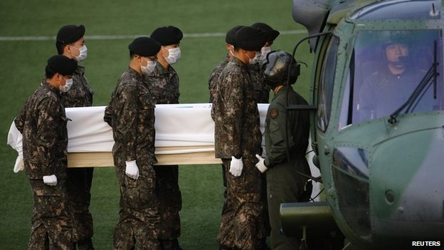South Korean military soldiers load a coffin of a passenger who was onboard the ship, before being transported to Ansan - 25 April 2014