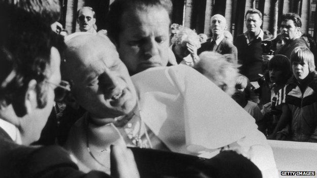 Pope John Paul II after being shot by would-be assassin Mehmet Ali Agca in St Peter's Square on 13 May 1981