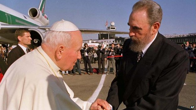 Cuban President Fidel Castro, right, greets Pope John Paul II after arriving at the Jose Marti Airport on 21 January 1998