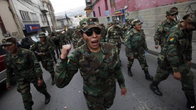 A female Air Force Sergeant joins the third day of protests by low ranking soldiers in La Paz, April 24, 2014.