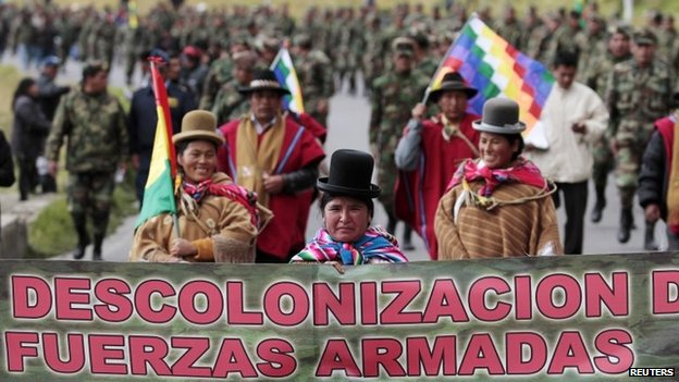 Indigenous authorities march in front of low-ranking army officers in La Paz, April 24, 2014.