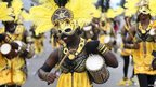 Lagos carnival dancers with drums and yellow feathers, Lagos, Nigeria - Monday 21 April