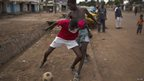 Boy playing street football, Bangui, CAR  - Wednesday 23 April 2014