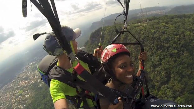Two people paragliding in Ghana in 2013