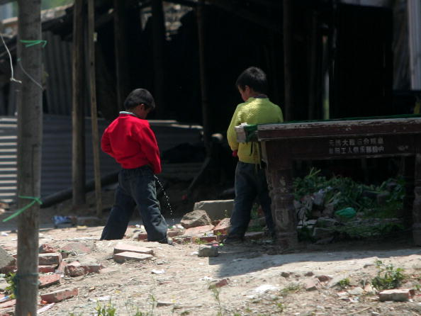 Two Chinese Children peeing on the street