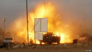 An explosion is seen during a car bomb attack at a Shia political organisation's rally in Baghdad, April 25