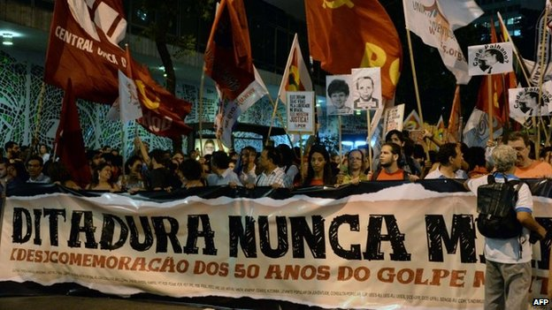 Activists in Rio de Janeiro mark the 50th anniversary of the coup that led to the 1964-1985 military rule, on April 1, 2014.