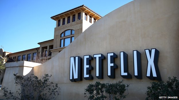 A sign is posted in front of Netflix headquarters in Los Gatos, California, on 22 January 2014