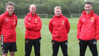 Manchester United's coaching team (from left) Phil Neville, Nicky Butt, Paul Scholes and interim manager Ryan Giggs