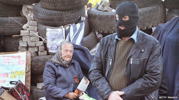 A pro-Russian activist guards outside a barricade in Donetsk, eastern Ukraine. Photo: 25 April 2014