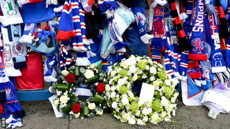 Scarves and wreaths left at Ibrox in tribute to the late Sandy Jardine