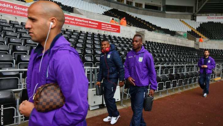 Aston Villa players arrive ahead of the Barclays Premier League match between Swansea City and Aston Villa