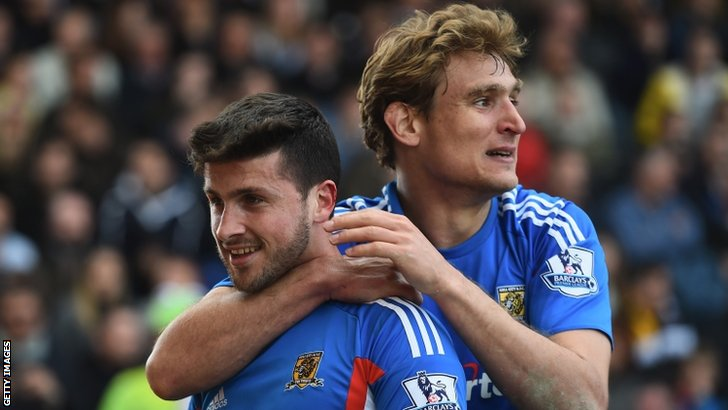 Shane Long of Hull celebrates with fellow goalscorer Nikica Jelavic