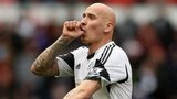 Jonjo Shelvey is congratulated by his Swansea team-mates