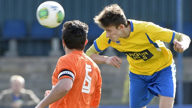 Match action from Bangor against Harland & Wolff Welders in Championship One