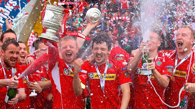 Cliftonville players celebrate lifting the Gibson Cup at Solitude