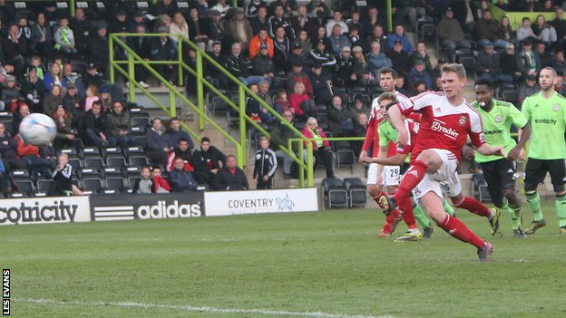 Johnny Hunt scores from the spot for Wrexham against Forest Green Rovers