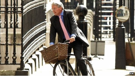 Andrew Mitchell on a bicycle