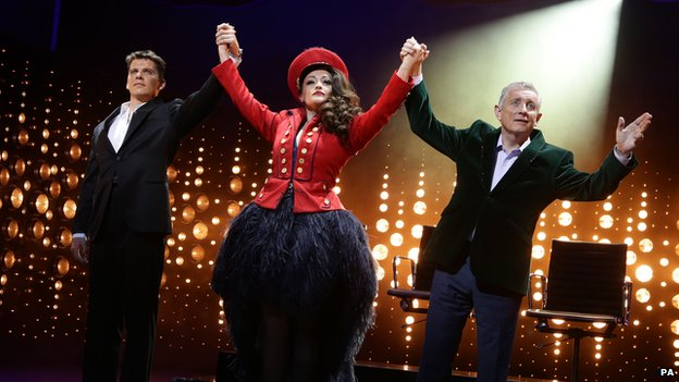 (Left to right) Nigel Harman (as Simon Cowell), Victoria Elliott (as Jordy) and Ashley Knight (as Louis Walsh)