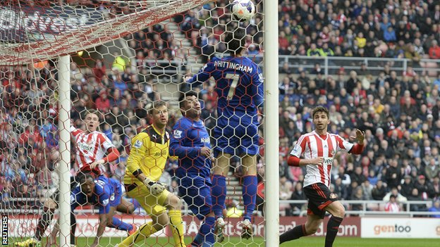 Sunderland striker Connor Wickham (left) watches as his header puts his side in front against Cardiff