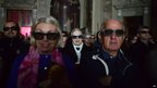 People wearing 3D glasses follow the broadcast of the canonisation mass in the church of Sotto il Monte Giovanni XXIII in Milan on April 27