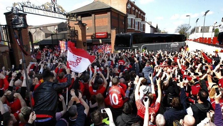 Liverpool fans greet their team