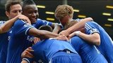 Chelsea celebrate a goal at Anfield