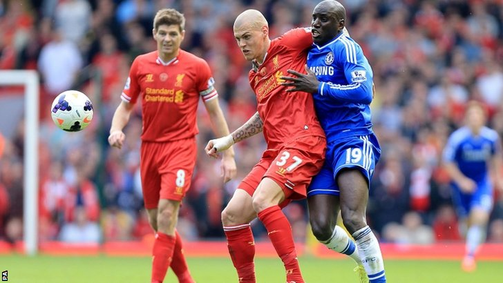 Liverpool's Martin Skrtel (left) and Chelsea's Demba Ba battle for the ball