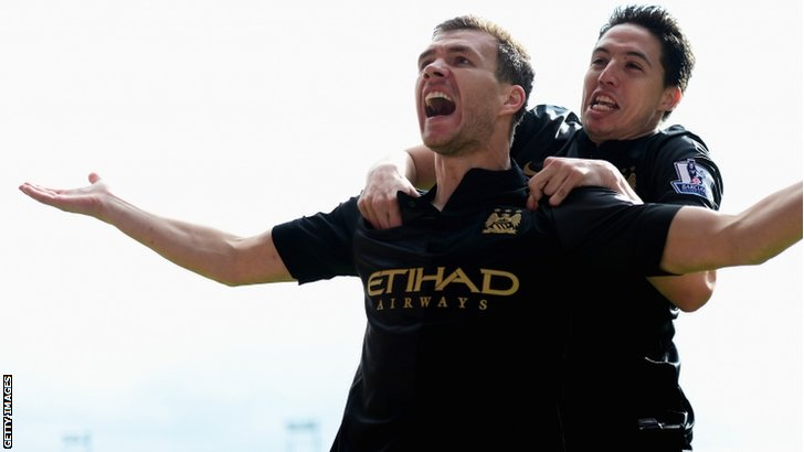 Edin Dzeko of Manchester City celebrates scoring the opening goal with Samir Nasri