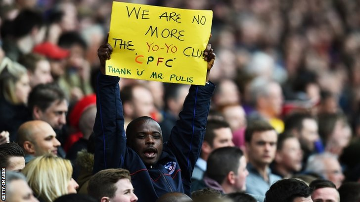 A Crystal Palace fan holds a message for manager Tony Pulis