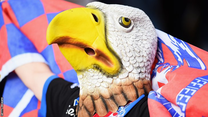 A Crystal Palace fan wears an eagle mask