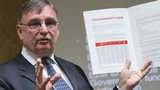 David Moffett holds up a copy of his manifesto for Welsh rugby