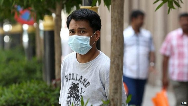 Man wears mouth and nose mask in the Red Sea coastal city of Jeddah. 27 April 2014