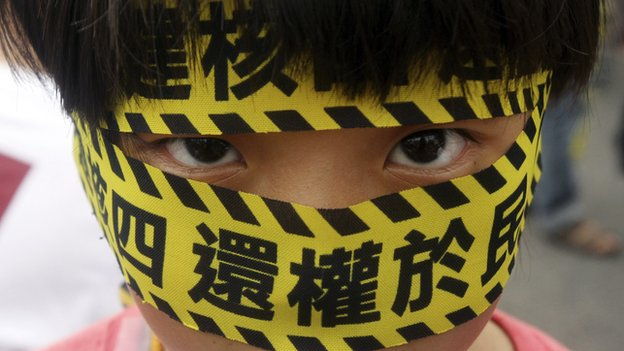 "A Taiwanese boy wears a slogan reading ""Stop the 4th Nuclear Power Plant. Give Power Back to People,"" during a protest against the construction of Taiwan""s fourth nuclear power plant to be completed in Taipei, Taiwan, on Sunday, 27 April, 2014"