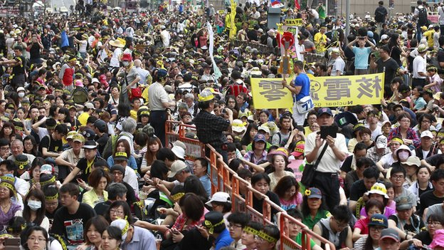 Activists take part in an anti-nuclear sit-in in front of the Taipei Railway station in Taipei on 27 April, 2014