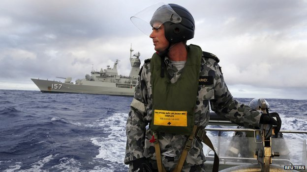 Leading Seaman William Sharkey searches for possible debris in the southern Indian Ocean in the continuing search for the missing Malaysian Airlines flight MH370 in this picture released by the Australian Defence Force on 17 April, 2014