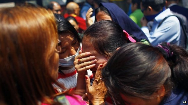 Relatives of mountaineers, killed in an avalanche on Mount Everest, cry during the funeral ceremony in Kathmandu, Nepal, Monday, April 21, 2014. Buddhist monks cremated the remains of Sherpa guides who were buried in the deadliest avalanche ever recorded on Mount Everest, a disaster that has prompted calls for a climbing boycott by Nepal's ethnic Sherpa community.