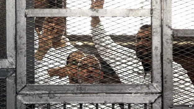 Muslim Brotherhood leader Mohammed Badie, bottom centre, and senior Brotherhood figurer Salah Soltan, right, in a courtroom in Cairo, Egypt - 1 April 2014