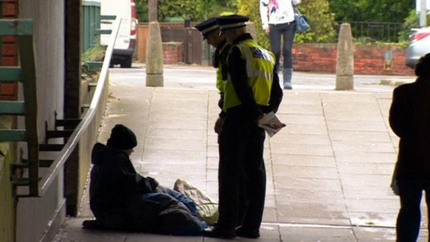 Police talking to a beggar